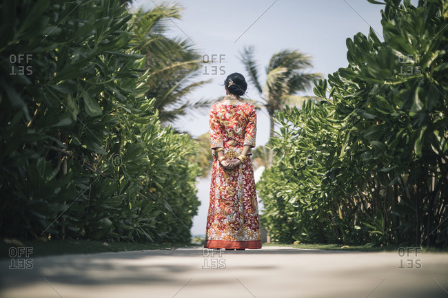 A young Chinese bride in traditional dress in Southeast Asia.