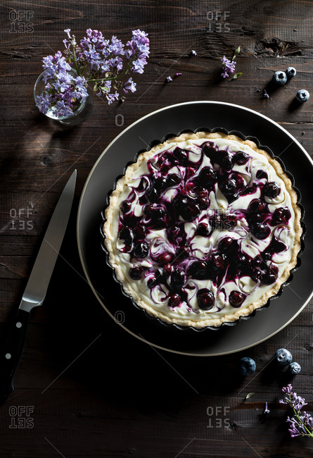 Blueberry Swirl Cheesecake Tart on a wood table