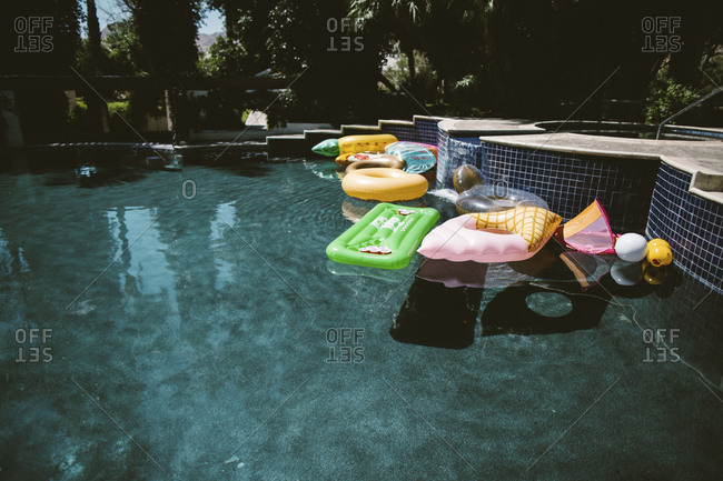 Various floaties in a pool