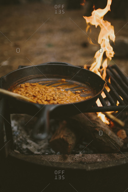 Baked beans cooking in cast iron skillet