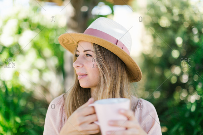 Woman with coffee in summer setting
