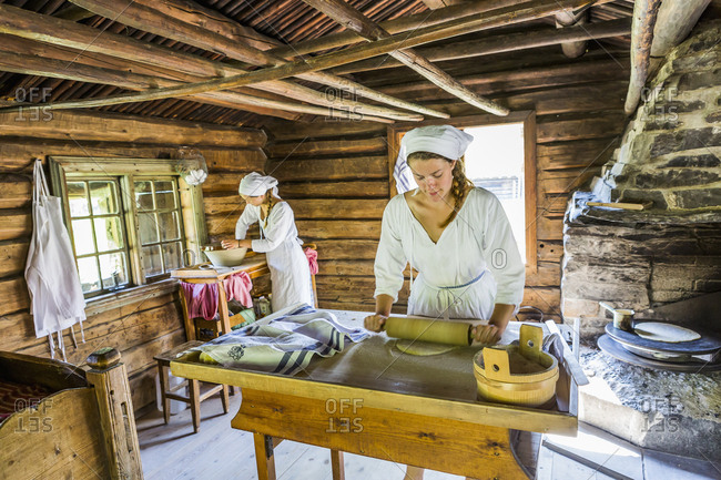Oslo, Norway - May 30, 2017: Bygdoy Peninsula, Folk museum (Norwegian Museum of Cultural History),  an open-air museum with historical buildings relocated from town and rural districts, preparing the typical Lefse bread