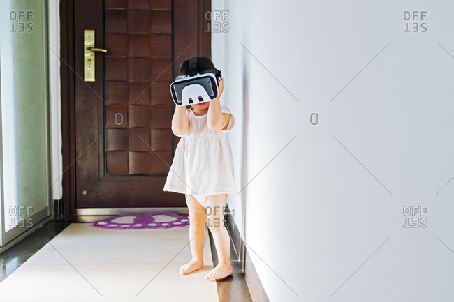 Asian little girl with virtual reality headset
