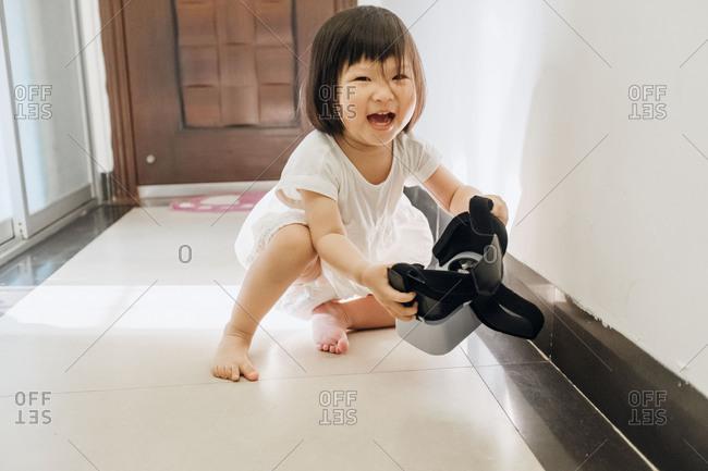 Asian little girl having fun with virtual reality headset