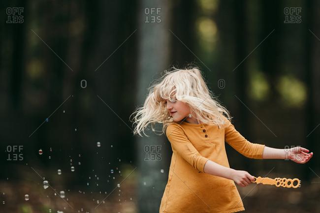 Girl waving a bubble wand