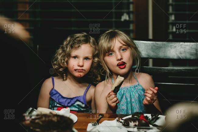 Girls eating messy dessert