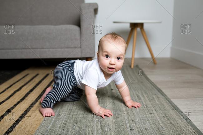 Infant boy propping himself up