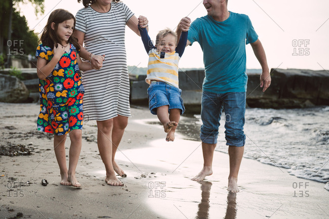 Parents with happy kids on beach