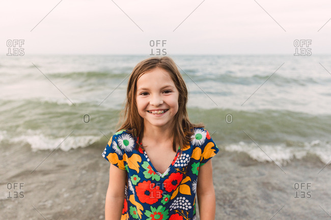 Girl with braces on a beach