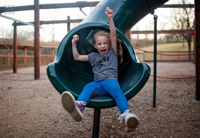 Girl at bottom of slide