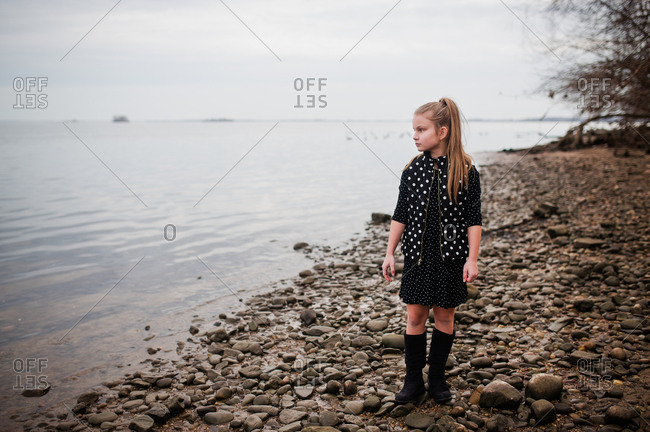 Girl looking to the water