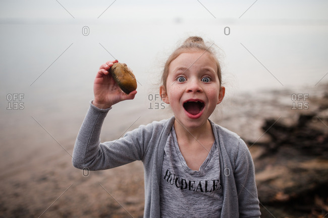 Girl excited to find the perfect rock