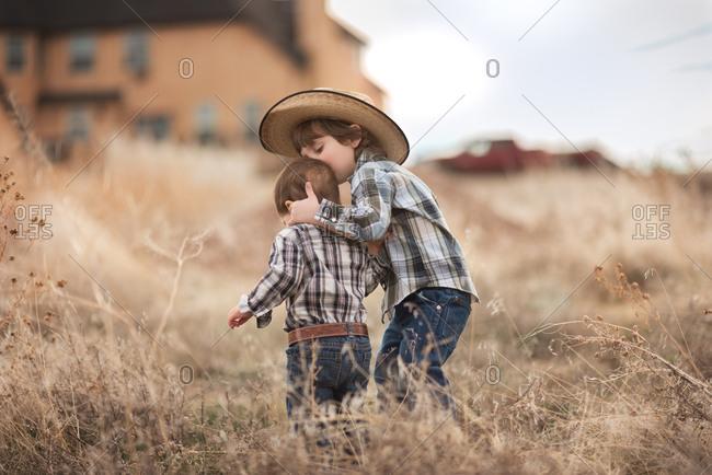 Loving boys in Western wear