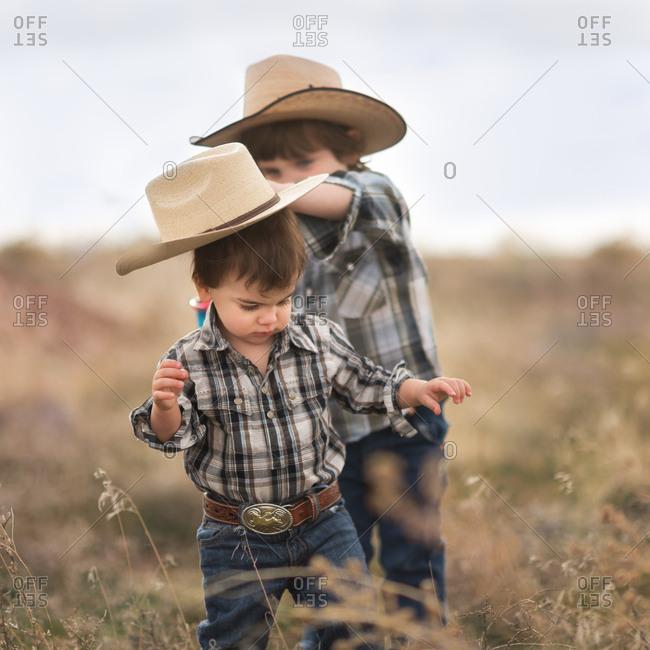 Boys in field in Western wear