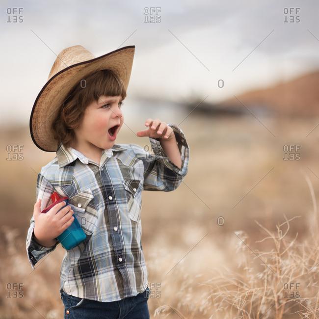 Surprised boy in Western clothing