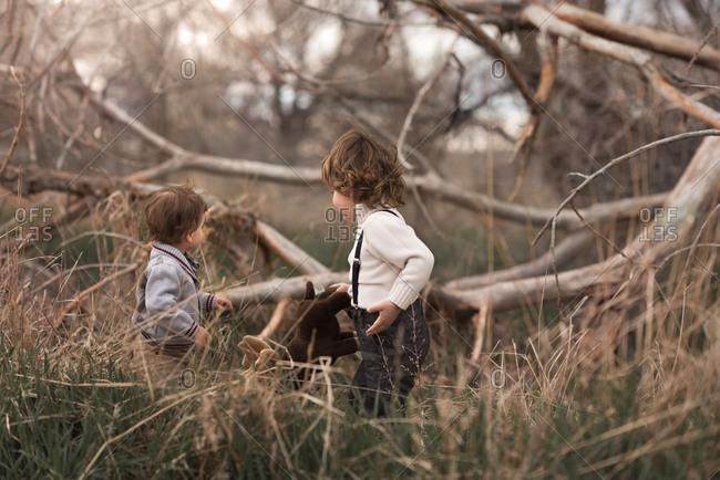 Kids in suspenders in a field
