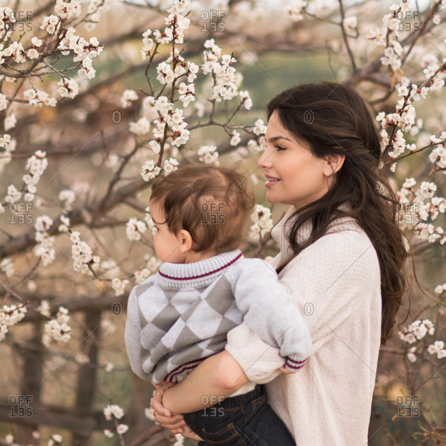 Woman with son by a flowering bush