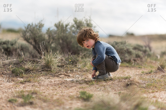 Young boy in a rural field