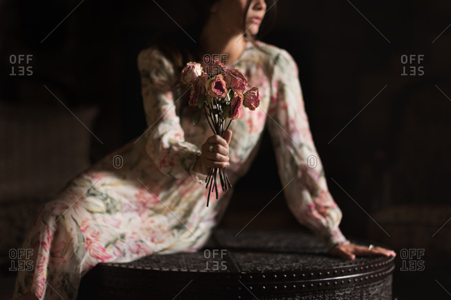 Woman holding dried rose bouquet