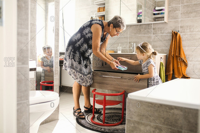 Grandmother and granddaughter in bathroom