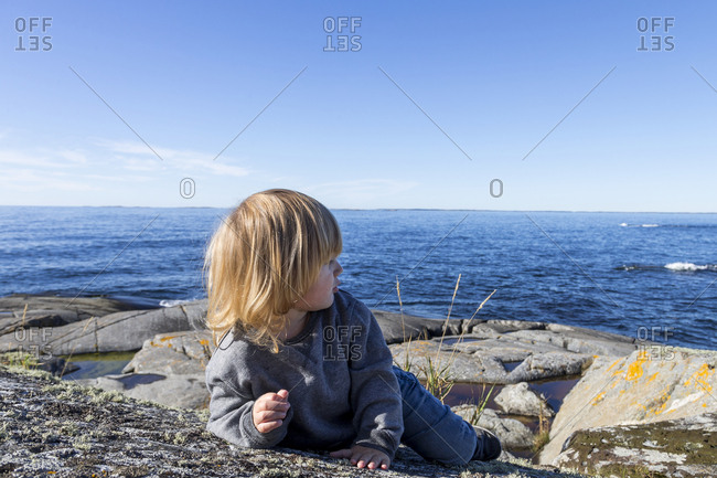 Boy on rocky coast