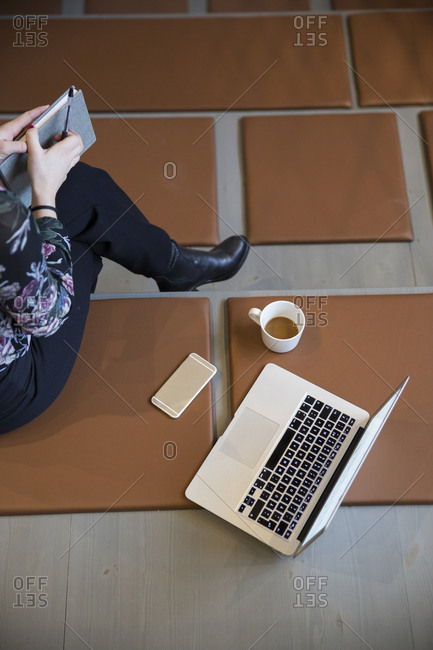 Woman with laptop and mobile phone