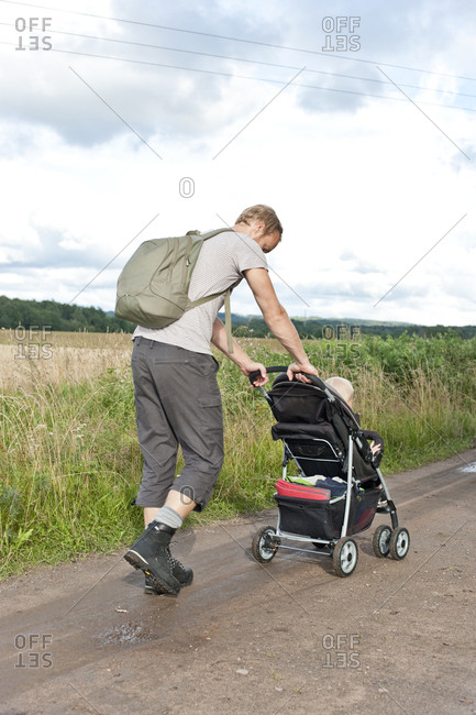 Man pushing pram