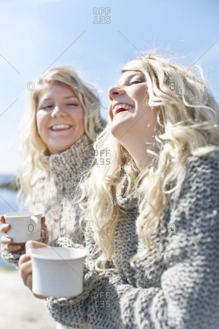 Happy young women having coffee