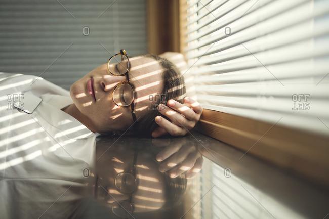 Female doctor sleeping by window