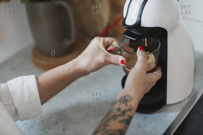 Young woman making coffee