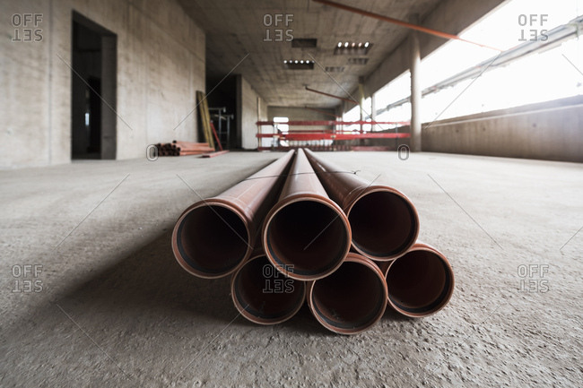 Pipes in an unfinished building under construction