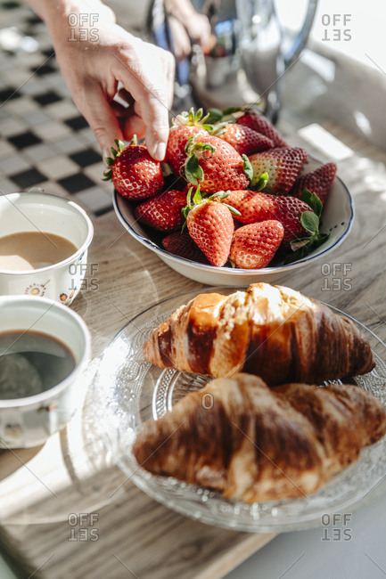 Strawberries- croissants and coffee in kitchen