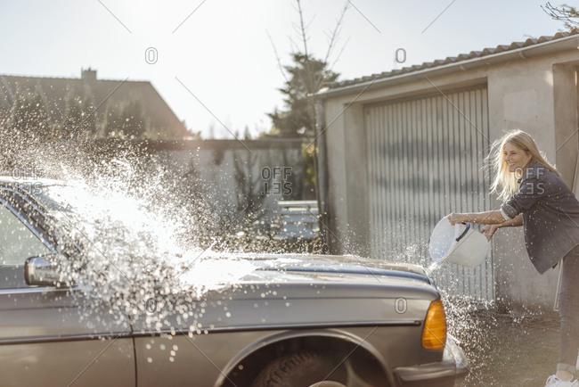 Woman washing her car