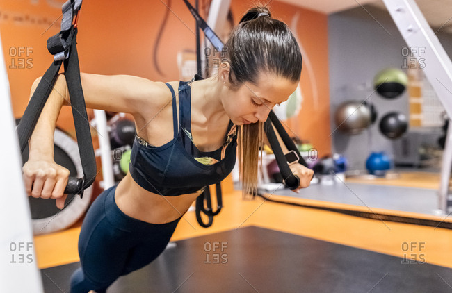 Woman doing suspension training in the gym