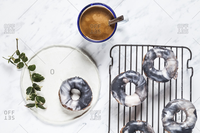 Homemade marble-glazed donuts and coffee