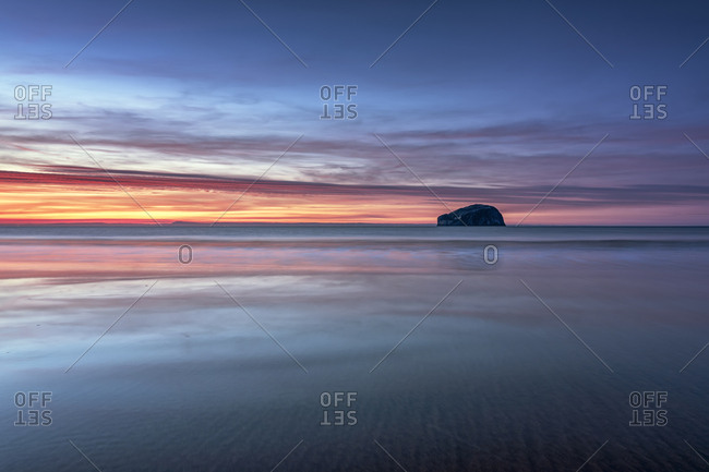 UK- Scotland- East Lothian- Bass Rock at sunset from Seacliff beach