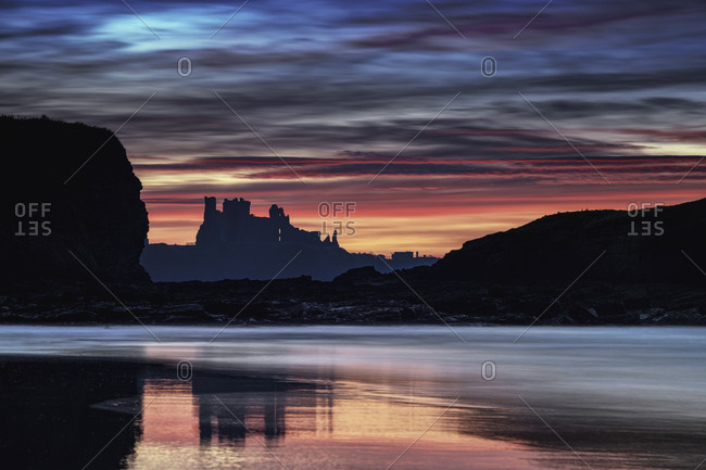 UK- Scotland- East Lothian- Tantallon Castle at sunset from Seacliff beach