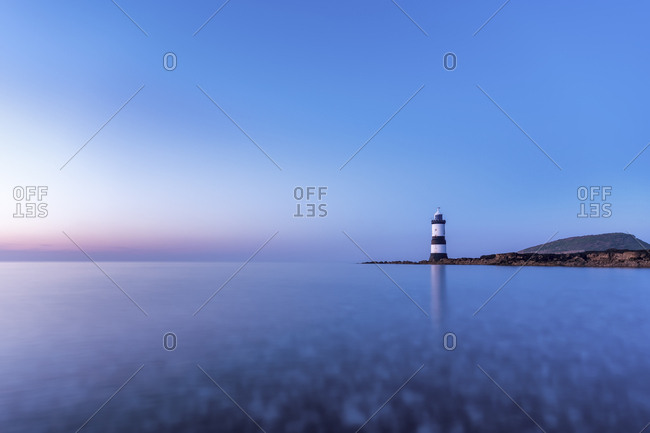 UK- Wales- Anglesey- Penmon- Dinmor Point- Trywn Du Lighthouse with Puffin Island in the background