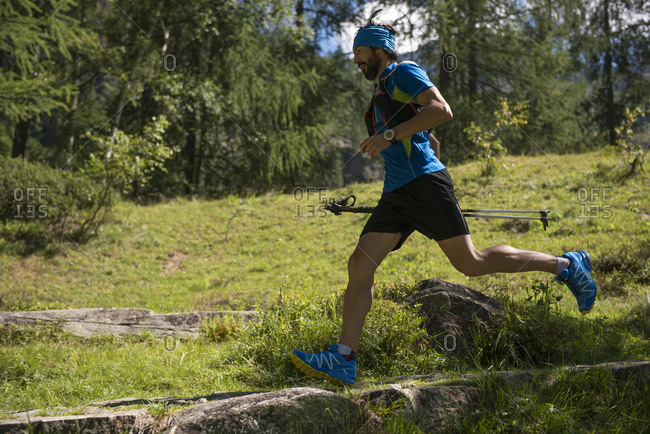 Italy- Alagna- trail runner on the move in forest