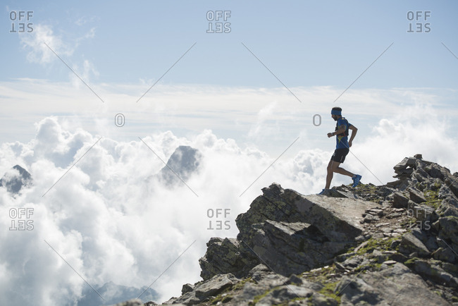 Italy- Alagna- trail runner on the move near Monte Rosa mountain massif