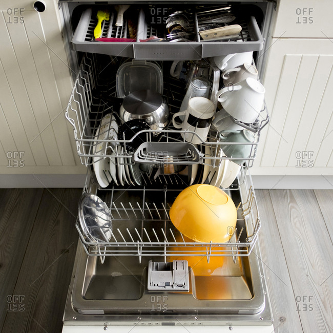 High angle view of utensils in dishwasher at kitchen