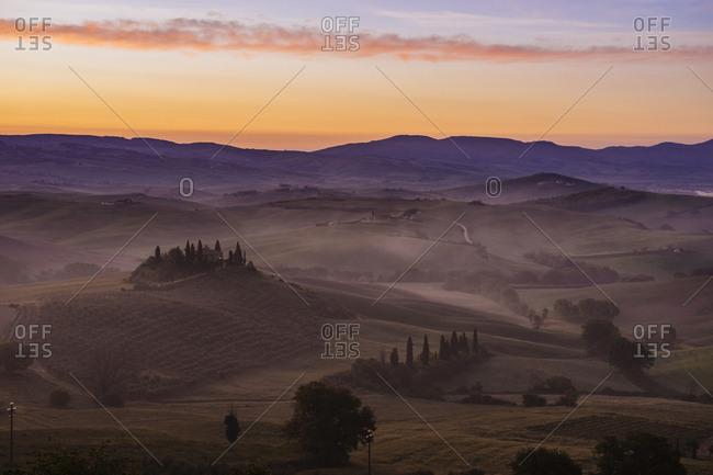 Scenic view of landscape in foggy weather during dawn