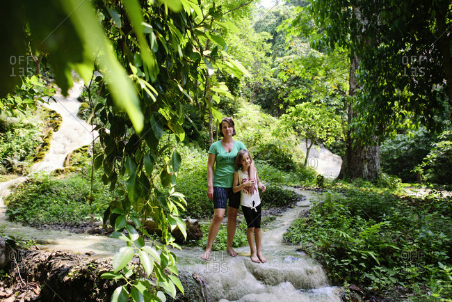 Mother and daughter standing at Bua Thong Waterfalls