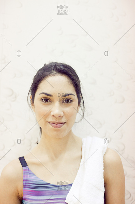 Portrait of smiling young woman in gym