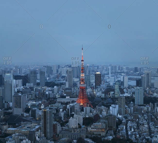 Aerial view of illuminated Tokyo Tower amidst cityscape at dusk