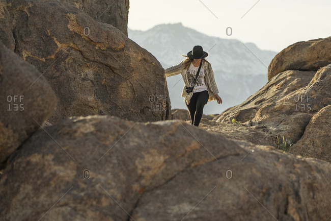 Young woman hiking on mountain against sky