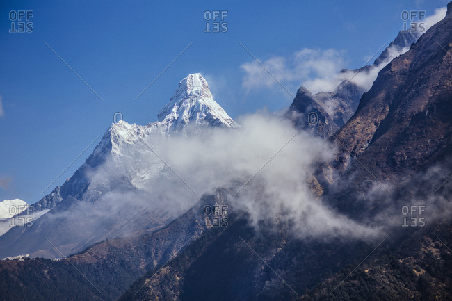 Low angle view of mountains against blue sky at Sagarmatha National Park