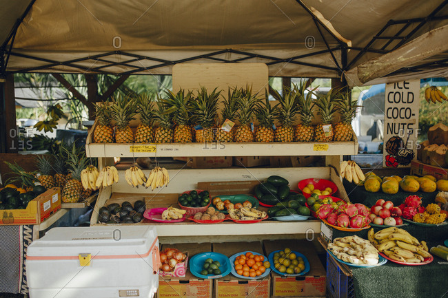 Various fruits arranged at market stall