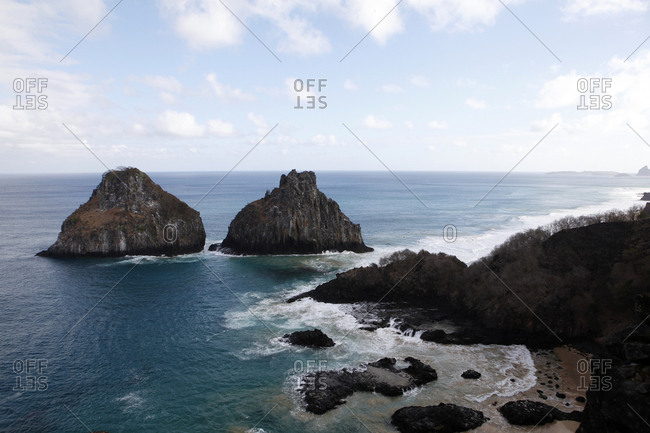 Scenic view of rock formations in sea at Fernando de Noronha against sky
