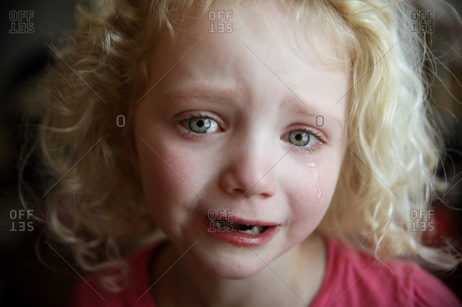 Close-up portrait of girl crying at home